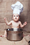 Little girl in a kitchen hood Royalty Free Stock Photography