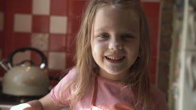 Little girl on kitchen. stock footage