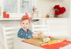 Little girl in the kitchen. Making cookies stock image