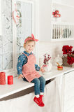 Little girl in the kitchen making cookies. Little girl baking cookies in the kitchen royalty free stock photo
