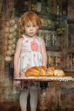 Little girl in the kitchen Royalty Free Stock Images