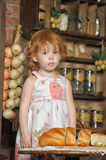 Little girl in the kitchen. Little red-haired girl in the kitchen Royalty Free Stock Photography