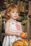Little girl in the kitchen. Little red-haired girl in the kitchen Royalty Free Stock Images
