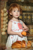 Little girl in the kitchen. Little red-haired girl in the kitchen Royalty Free Stock Photo