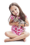 Little girl with a kitten Stock Photos