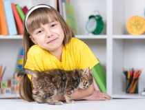 Little girl with kitten at home Royalty Free Stock Image
