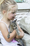 Little girl and kitten Royalty Free Stock Images