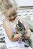 Little girl and kitten Royalty Free Stock Image