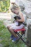 Little girl and kitten Stock Photography