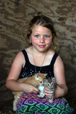 Little girl with kittens Stock Photos