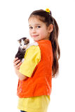 Little girl with kitty in hands Stock Image