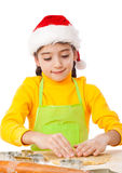Little girl kneading for Christmas cooking Royalty Free Stock Photo