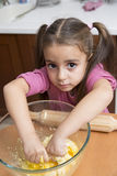 Little girl kneading cooking royalty free stock images