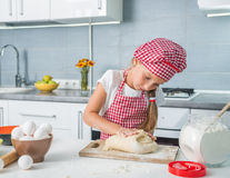Little girl kneading a dough Royalty Free Stock Photo