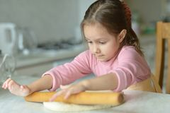 Little girl kneading dough Royalty Free Stock Photo