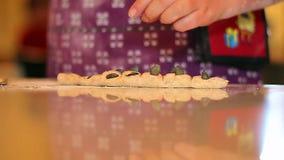 Little girl kneading dough (People), 2 shots Stock Photography