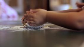 Little girl kneading dough (People) Royalty Free Stock Photo
