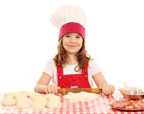 Little girl kneading dough Stock Photo