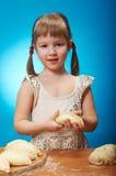 Little girl kneading dough Royalty Free Stock Image