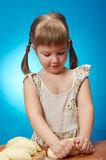 Little girl kneading dough Royalty Free Stock Photos