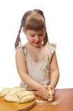 Little girl kneading dough Royalty Free Stock Photography