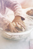 Little girl kneads dough Royalty Free Stock Photos