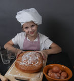 Little girl kneads  dough Stock Photo