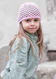 Little girl in knit pink hat Stock Photo