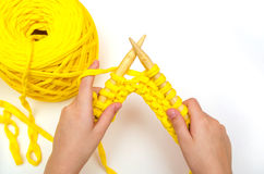 Little girl knits bamboo needles of a thick yarn Stock Photography