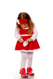 A little girl in a knitted dress Stock Image