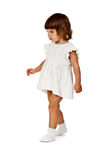 Little girl in a knitted dress in the studio Royalty Free Stock Photo