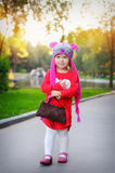 Little girl in a knitted hat autumn owls Royalty Free Stock Photos