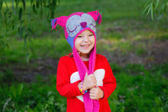 Little girl in knitted hat owl Royalty Free Stock Image