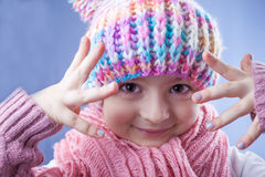 Little girl in knitted hat, scarf and mitten Stock Photo