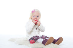 Little girl in a knitted jacket Royalty Free Stock Image