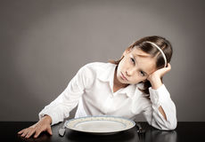 Little girl lack of appetite Stock Image