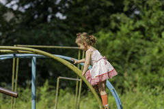 Little girl on a ladder on the playground. Royalty Free Stock Image