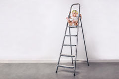 Little girl at the ladder Royalty Free Stock Image