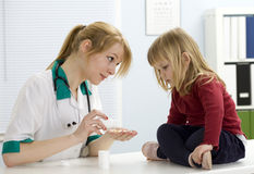 Little girl at lady doctor Stock Photo