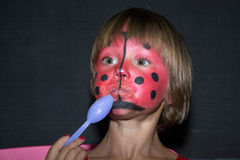 Little girl with ladybug face paint Royalty Free Stock Photo
