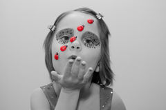 Little girl with ladybug face paint Royalty Free Stock Photography