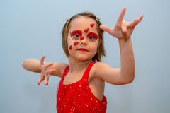 Little girl with ladybug face paint Stock Image