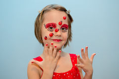 Little girl with ladybug face paint Royalty Free Stock Photos