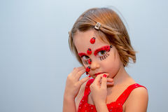 Little girl with ladybug face paint Royalty Free Stock Image