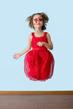 Little girl with ladybug face paint jumping Royalty Free Stock Image