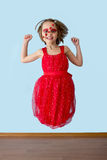 Little girl with ladybug face paint jumping Royalty Free Stock Photos