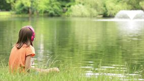 Little girl at lakeside stock footage