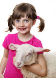 Little girl with a lamb Stock Photos