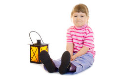 Little girl with lantern Stock Images