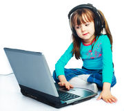 Little girl with a laptop Stock Image